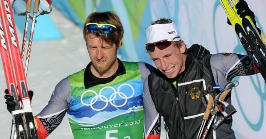 Noch ziemlich erschöpft nach ihrem Silberlauf: Axel Teichmann (li.) und Tim Tscharnke, Copyright: picture-allliance
