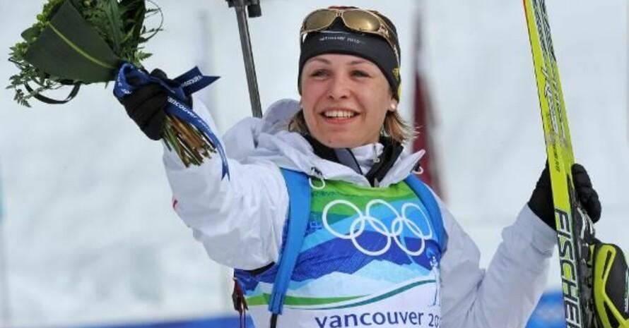 Magdalena Neuner nach ihrem Sturmlauf zu Gold; Copyright: picture-alliance