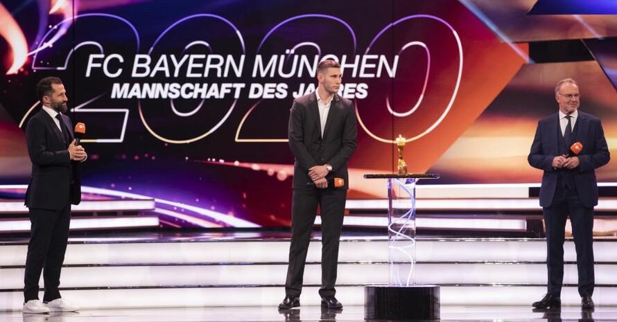 Hasan Salihamidzic, Niklas Süle und Karl-Heinz Rummenigge (v.l.) nahmen die Auszeichung für den FC BAyern München entgegen. Foto: picture-alliance