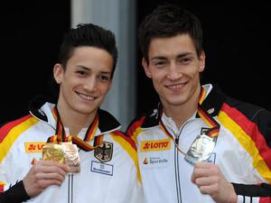 Marcel Nguyen (l.) und Philipp Boy gewinnen je zwei Medaillen für den Deutschen Turner Bund. Foto: picture-alliance