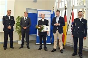 v.l.. Ralf Flohr, Andreas Rhöner, Aaron Sauter, Staatssekretär Dr. Heck, Volker Pfeiffer. Foto: DPSK