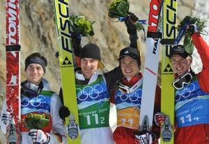 Michael Neumayer, Andreas Wank, Martin Schmitt and Michael Uhrmann (v.li.) feiern ihren zweiten Platz beim Teamspringen. Copyright: picture-alliance
