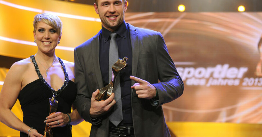 Christina Obergföll und Robert Harting sind die Sportler 2013. Foto: picture-alliance