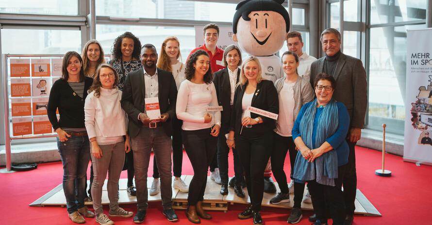 Teilnehmer*innen der Podiumsdiskussion auf der Frankfurter Buchmesse mit Trimmy Foto: DOSB