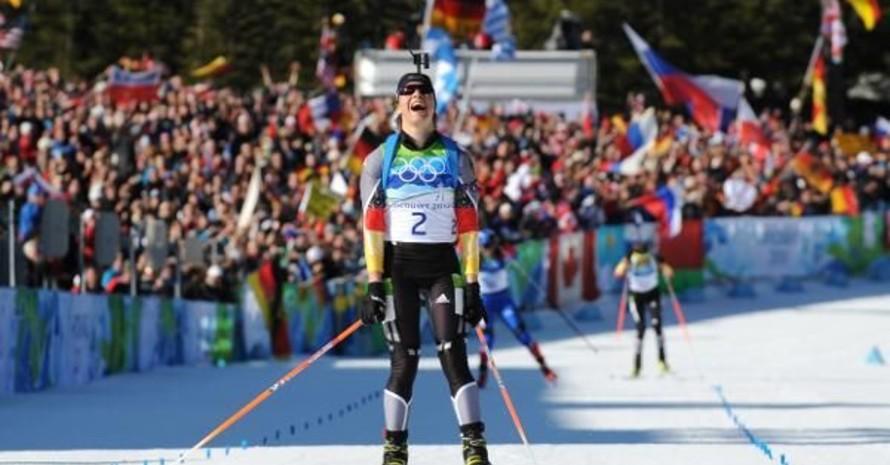 Da weiß sie, dass sie gewonnen hat: Magdalena Neuner nach ihrem zweiten Triumph bei den Olympischen Winterspielen in Vancouver. Copyright: picture-alliance