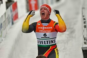 Große Freude bei Felix Loch bei der Heim-WM in Winterberg. Foto: picture-alliance