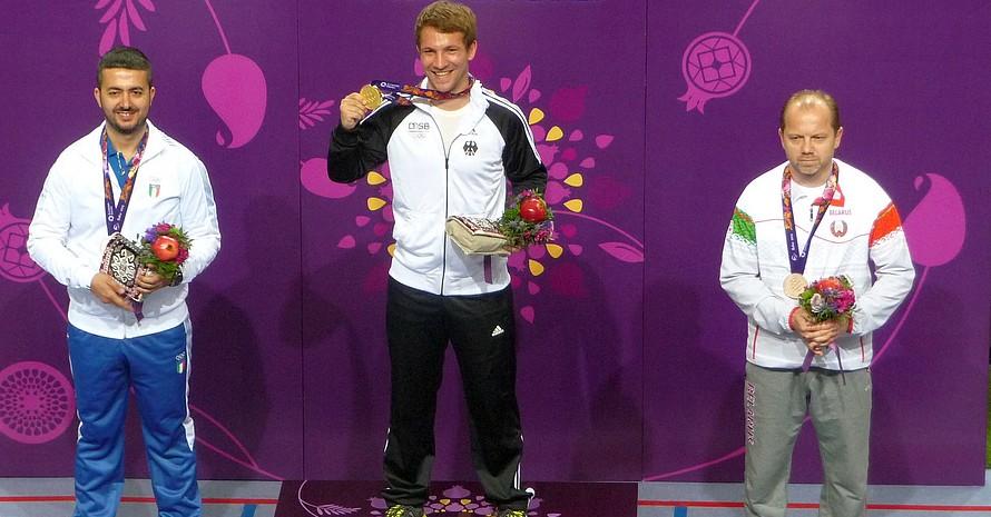Goldjunge Junghänel strahlt bei der Siegerehrung über seinen überraschenden Sieg und den Quotenplatz für Rio. Foto: DOSB