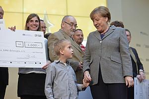 Besondere Momente für kleine und große Preisträger: wenn Angela Merkel persönlich gratuliert. (Bild: DOSB/BVR)