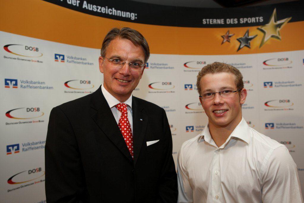 Uwe Fröhlich, Präsident des Bundesverbandes der Deutschen Volksbanken und Raiffeisenbanken (BVR) und Turnweltmeister Fabian Hambüchen